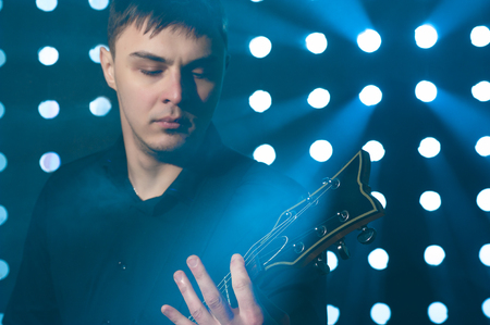 hand jamming: Portrait of young man playing on electric guitar Stock Photo
