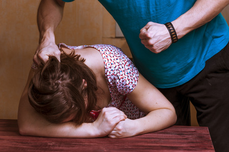 beating: Domestic violence: aggressive man beating up his wife. Stock Photo