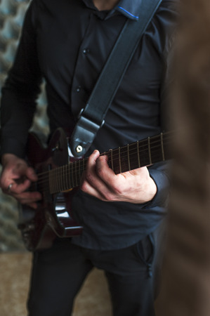 hand jamming: Male musician playing on electric guitar. Selective focus. Stock Photo