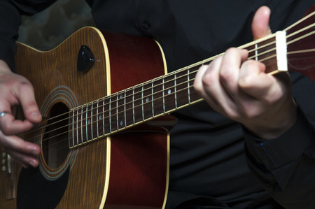 hand jamming: Closeup of mans hands playing on guitar