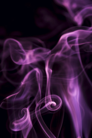 black smoke: Motion of purple smoke on black background