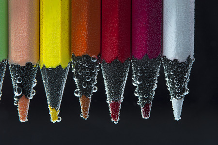 peachy: Colorful pencils in soda water. Stock Photo