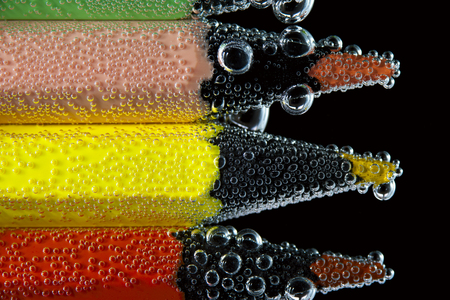 peachy: Bright pencils in sparkling water. Back to school concept.
