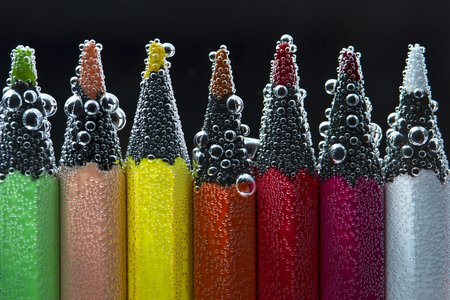 peachy: Colorful bright pencils in sparkling water. Back to school concept