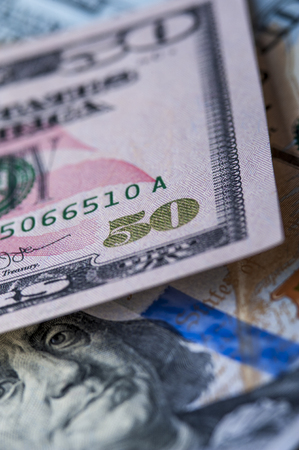 fifty dollar bill: Close up of fifty dollar bill on the background of one hundred dollar bill