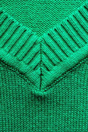 Closeup of knitted woolen fabric texture. Emerald knitwear Stock Photo