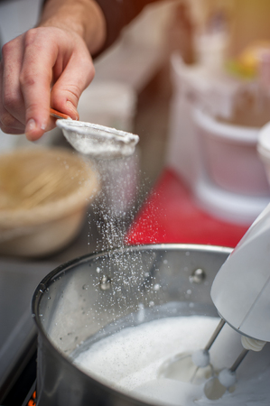 Cropped shot of male hands cooking cream