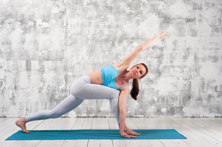 calmness: Fit caucasian woman practicing yoga indoors Stock Photo