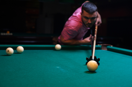 snooker hall: Concentrated man aiming to take the snooker shot. Stock Photo