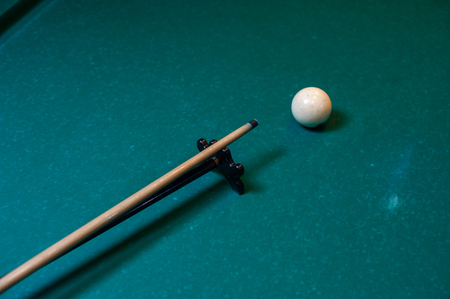 Playing billiard background, cue with snooker ball Stock Photo