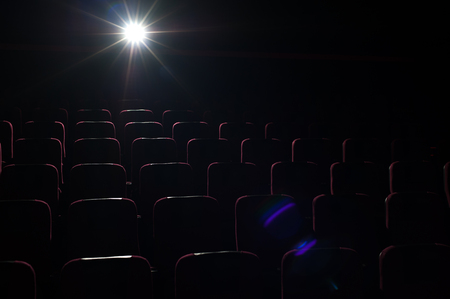 Movie theater background, red seats in cinema hall