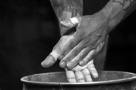 Closeup of male hands with talc powder