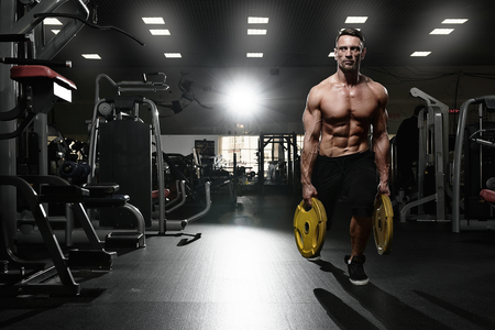 Fitness model doing lunges exercise with weights