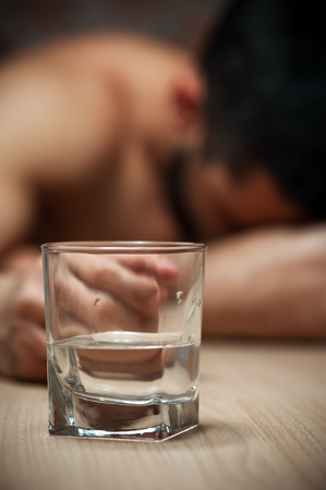 Alcoholic man sleeping at the table