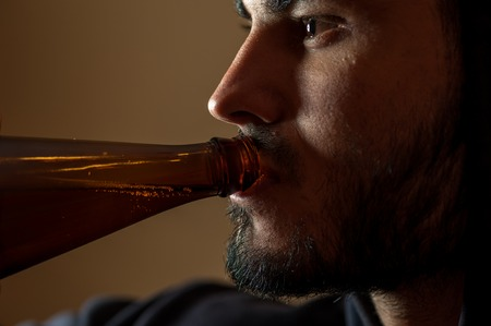 wasted: Young drunken man with beer bottle