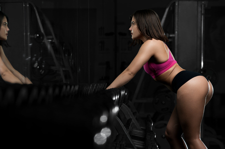 Young fitness female resting in gym