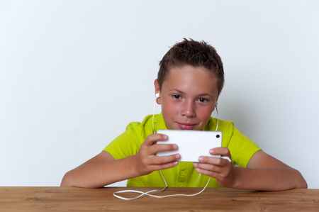 Cheerful tween boy using his smatrphone