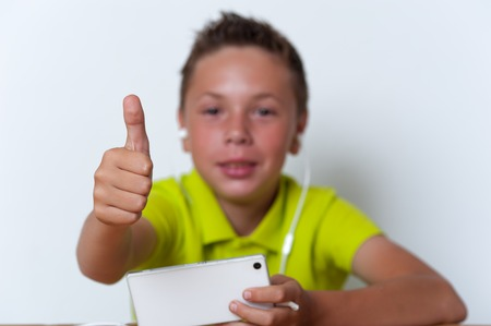 Smiling tween boy using his smartphone