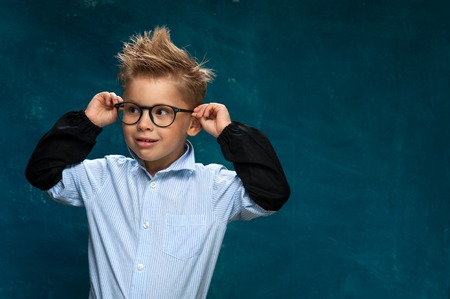 Funny portrait of little child with eyeglasses