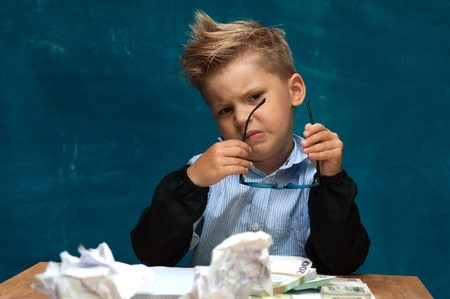 Child imitating tired businessman or office worker Stock Photo