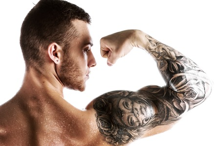 Handsome fitness model showing biceps muscles Stock Photo