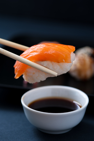 Chopstick with Salmon sashimi and soy sauce Stock Photo