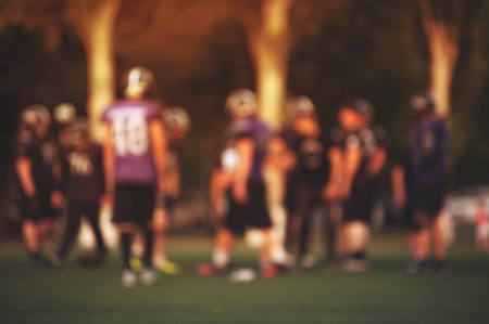 Blurry American football players in action. Stock Photo