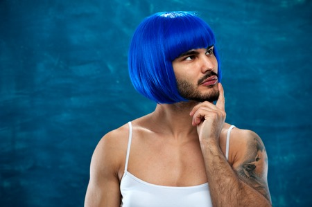 Attractive cross dressing male person in blue wig
