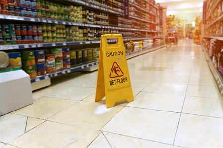 Yellow sign - caution wet floor Imagens - 94451646