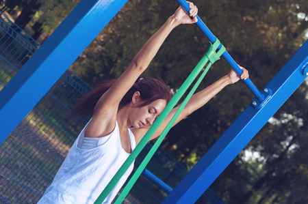 Beautiful woman exercising in outdoors gym