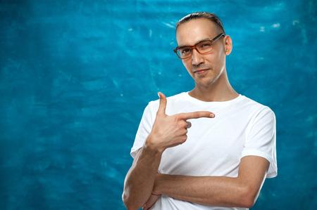 Cute man posing on blue background