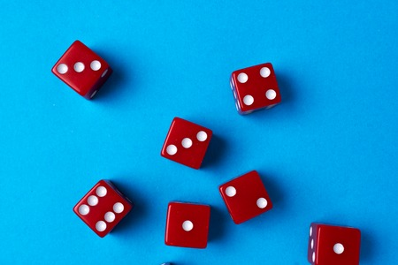 Red gaming dices on blue background