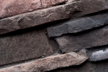 Close-up of a grey rustic rough stone in a wall Stock Photo