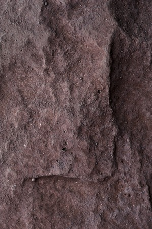 Close-up of joint of two red rustic bricks