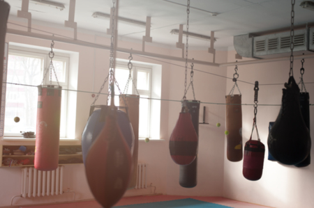 Punching bags hanging on chains on the hooks Stock Photo