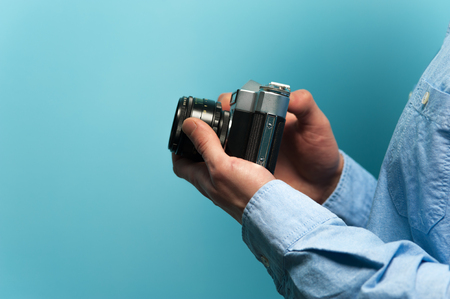 Hands of a young male photographer 스톡 콘텐츠