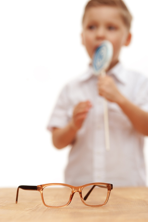 Funny cute little boy in a white shirt Stock Photo