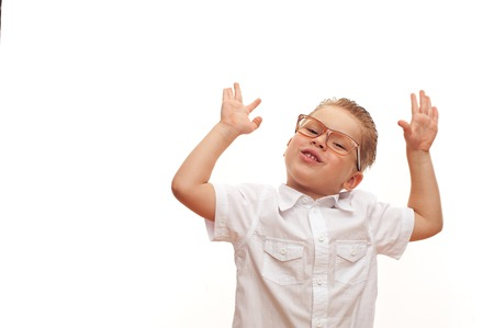 Smart cheerful little boy in a shirt Stock Photo