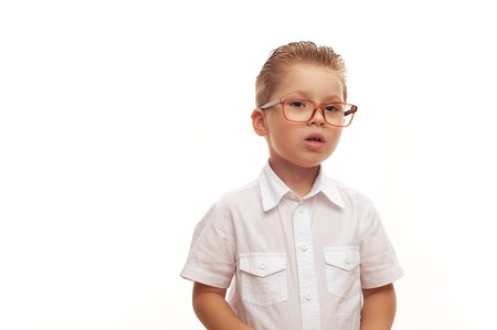 Cute charming little boy wearing white shirt and glassses