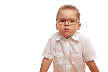 Funny cute little boy in glasses posing on white background Stock Photo
