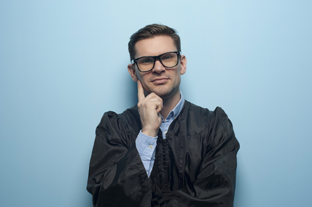 Happy portrait of young man graduate student Stock Photo