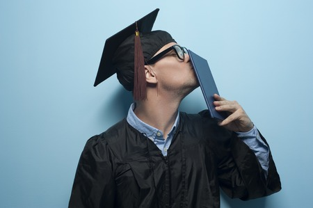 Happy graduate man with diploma in hands. Stock Photo