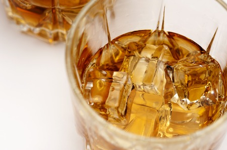 Glasses of scottish whiskey with ice cubes Stockfoto