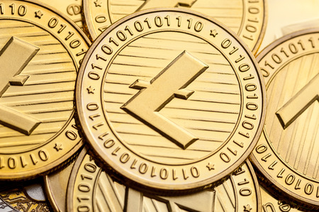 Group of golden litecoin coins, close-up.