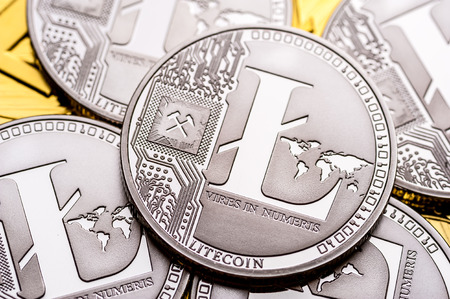 Group of silver litecoin coins, close-up.
