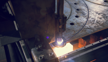 Laser Cutting Machine Makes Round Cuts On An Iron Sheet