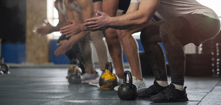 Sporty Male Adults With Chalk Powder During Workout Session. Stock Photo