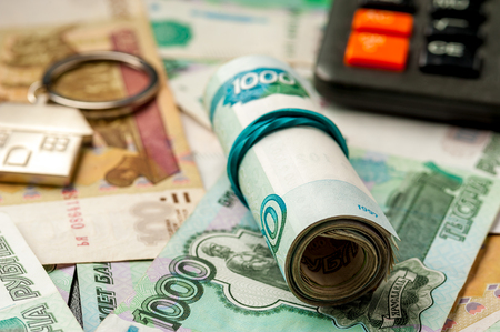 Keychain on the background of russian ruble banknotes Archivio Fotografico