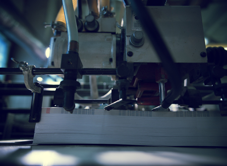 Large format printer with a pile of paper