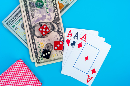 Playing Cards, Gaming Dices and Dollar Bills Stack on Background Imagens